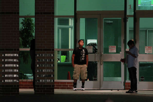 Students nervously wait to enter Spring High School for school at 6:30 a.m. Monday, Sept. 9 and are still feeling the aftermath of the Sept. 4 stabbing and the chaos that shook Sunday's memorial. (Mayra Beltran/Houston Chronicle)