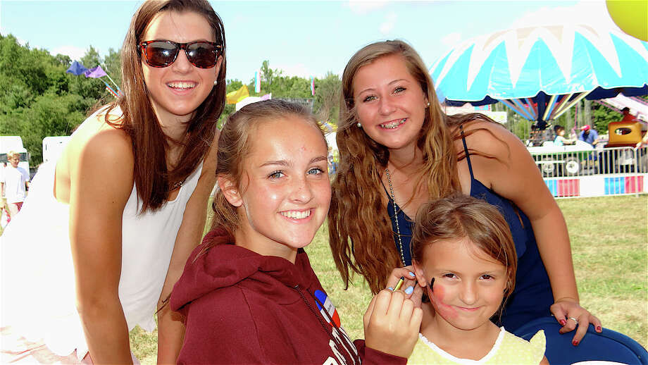 Having a few laughs at the face-painting station at St. Pius X Church's picnic Sunday were Jen O'Neill, Catherine Regan, Caroline Ihlefeld and Katie Freimuth. Photo: Contributed Photo, Mike Lauterborn / Fairfield Citizen contributed