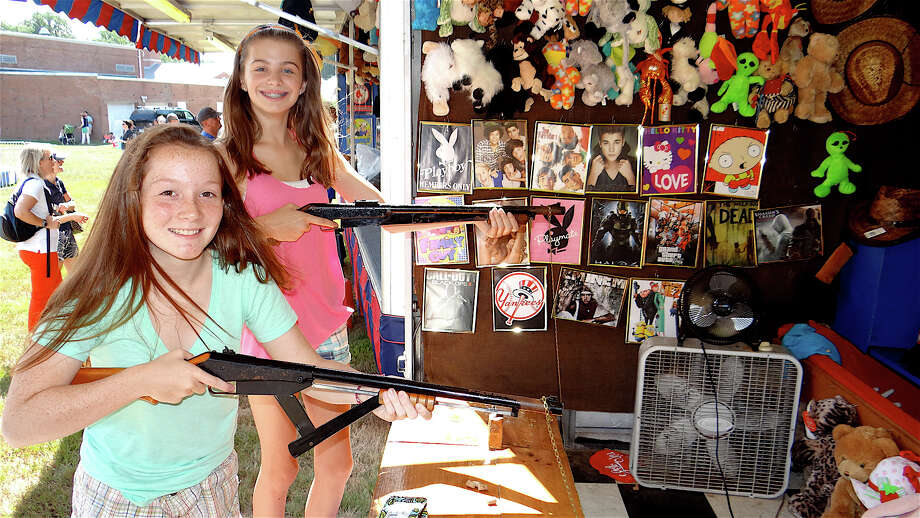 Taking aim to win prizes Sunday at the St. Pius picnic were Olivia Hawkins, 13, and Clare Sullivan, 12, of Fairfield. Photo: Mike Lauterborn / Fairfield Citizen contributed