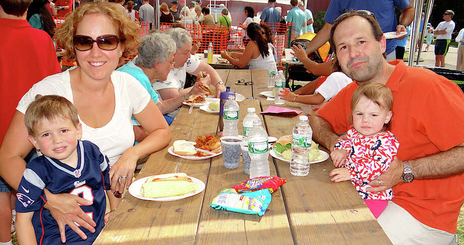 Enjoying the picnic fare Sunday at St. Pius X parish were Kassandra and Michael Savicki of Fairfield and their children Ryan, 3, and Audrey, 1. Photo: Mike Lauterborn / Fairfield Citizen contributed