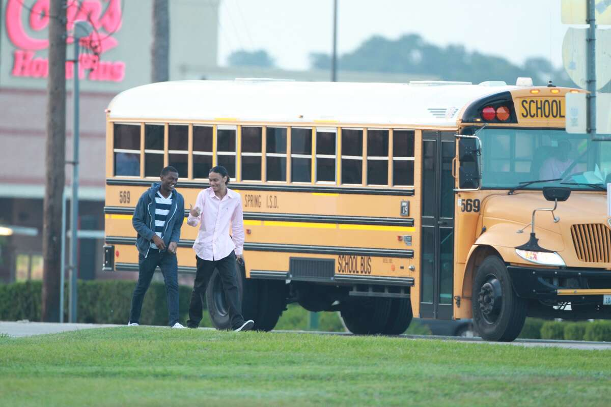 Students wait to enter Spring High School on Monday, Sept. 10, 2013.