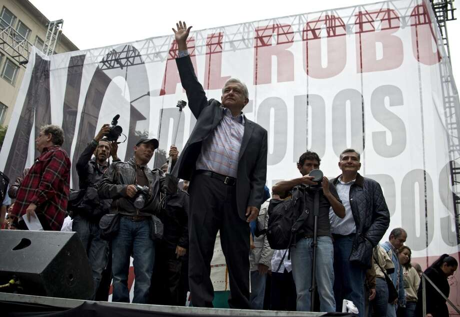 Mexican former presidential candidate and leader of the MORENA movement, Andres Manuel Lopez Obrador, waves after delivering a speech against the energetic reform proposed by Mexican President Enrique Pena Nieto, during a rally along Juarez Avenue in Mexico City, on September 8, 2013. Photo: YURI CORTEZ, AFP/Getty Images