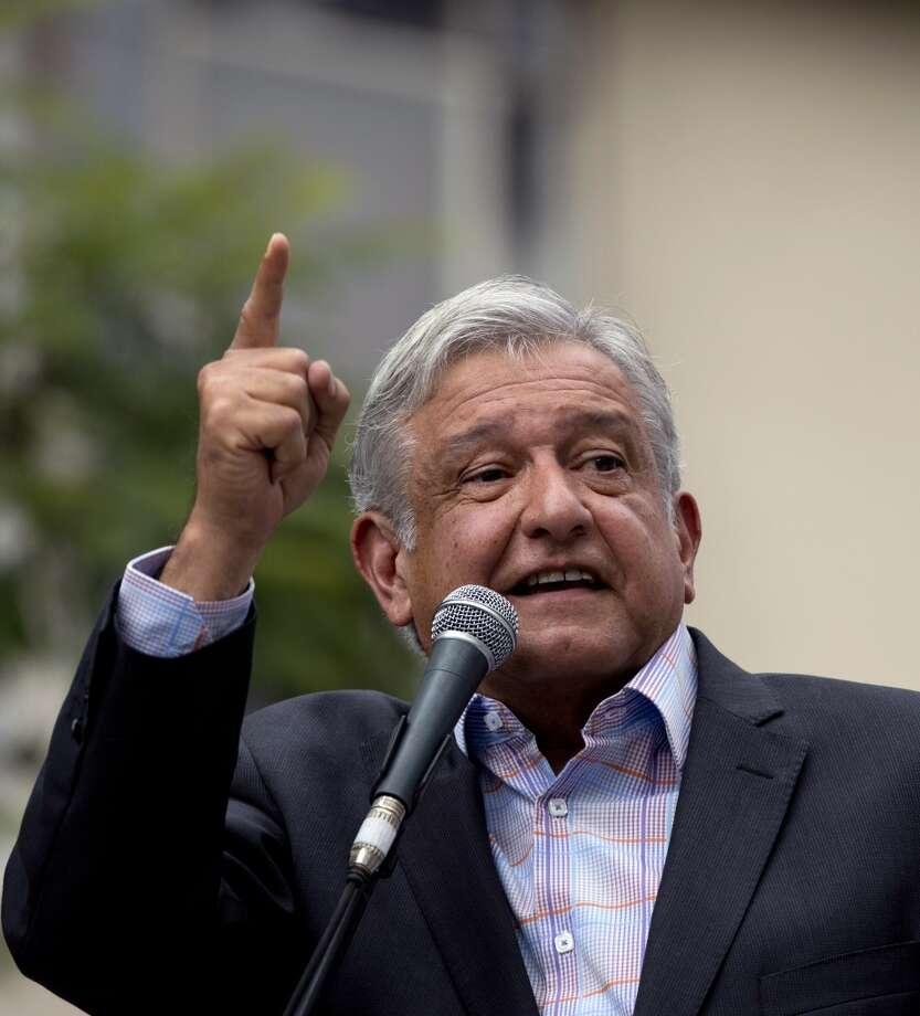Mexican former presidential candidate and leader of the MORENA movement, Andres Manuel Lopez Obrador, gestures as he delivers a speech against the energetic reform proposed by Mexican President Enrique Pena Nieto, during a rally along Juarez Avenue in Mexico City, on September 8, 2013. Photo: YURI CORTEZ, AFP/Getty Images