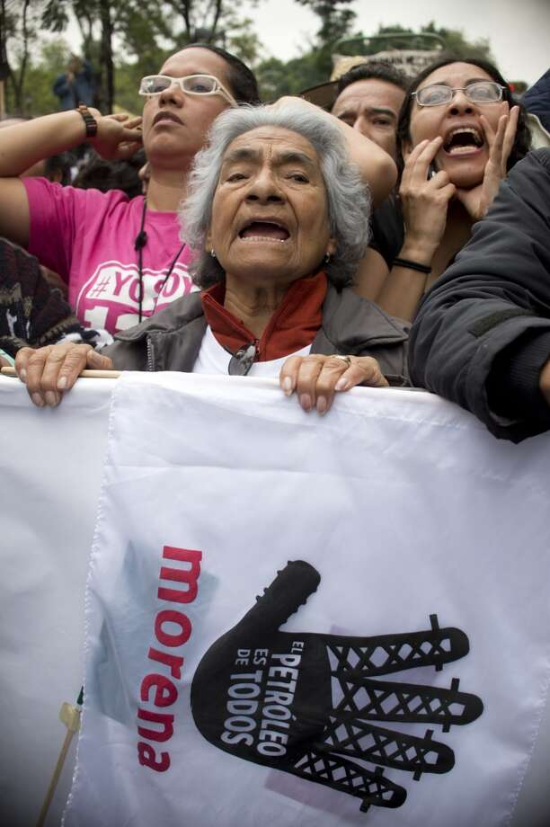 Supporters of Mexican former presidential candidate and leader of the MORENA movement, Andres Manuel Lopez Obrador, shout slogans against the energetic reform proposed by Mexican President Enrique Pena Nieto, during a rally along Juarez Avenue in Mexico City, on September 8, 2013. Photo: YURI CORTEZ, AFP/Getty Images