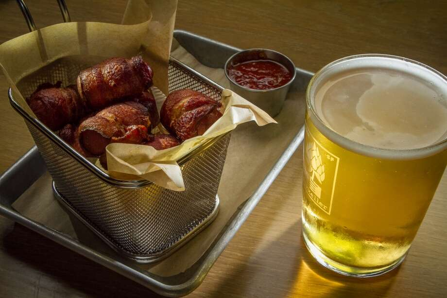 The Lil Smokies with an Upright Engelberg Pilsner at Mikkeller. Photo: John Storey, Special To The Chronicle