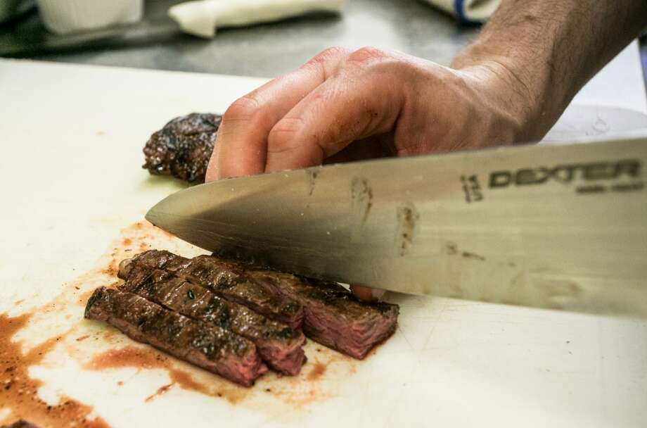 Skirt steak being cut for the Steak Frites at Mikkeller. Photo: John Storey, Special To The Chronicle