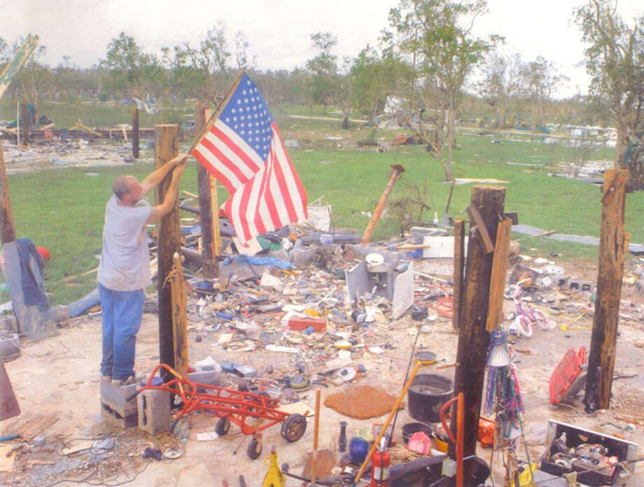 This picture is of my son Michael Casanover putting an American flag on what was left of his house after Ike hit. He lived on Oak Island, Texas in Chambers County the water got to at lease 15 feet in this area his house was 8 feet in the air. Photo: Cynthia Sanders-Froehlich