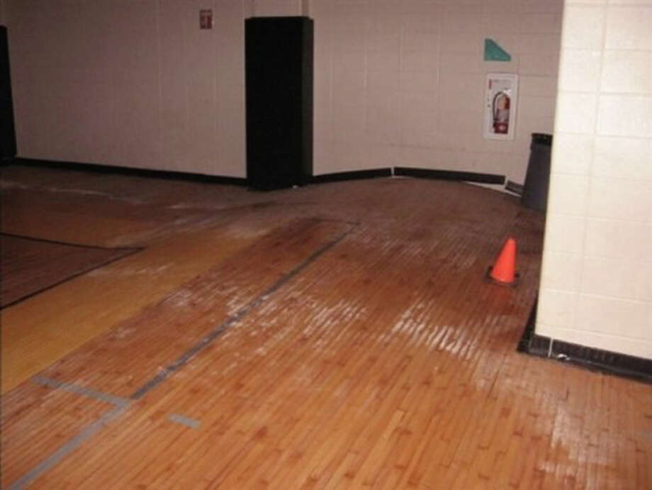 This is a picture of the gym in the intermediate school where my husband works. The floor completely buckled. Photo: Amy Graham