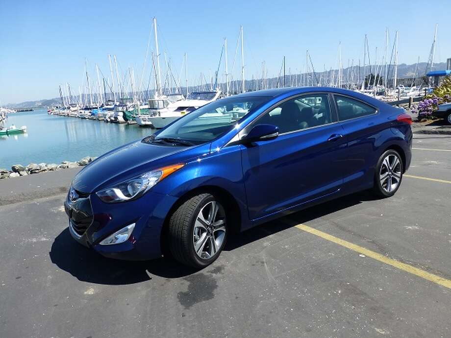 The 2013 Hyundai Elantra coupe would do well to morph itself back into a four-door. To my eye, the Elantra sedan is a more svelte and stylish-looking car. (All photos by Michael Taylor)