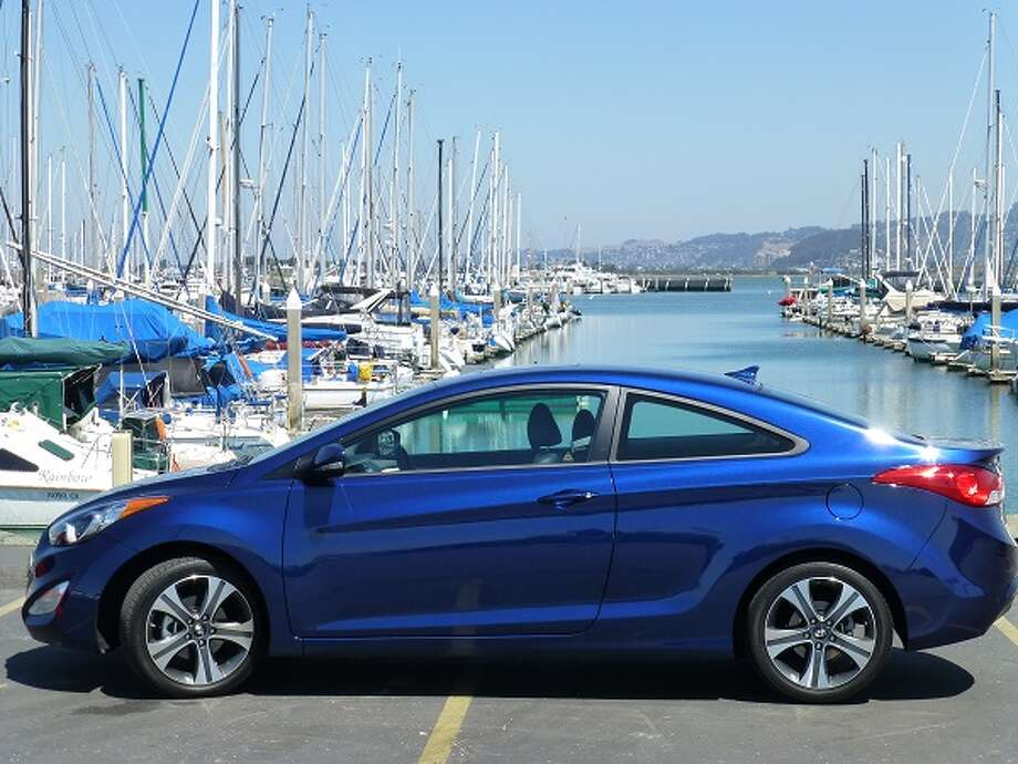 By chopping out two of the sedan's four doors, and making this coupe, Hyundai lost the graceful looks of the four-door. For a car that sacrifices convenience of ingress/egress for the sake of trying to be better looking, the two-door coupe manages to look more conservative than the four-door version.