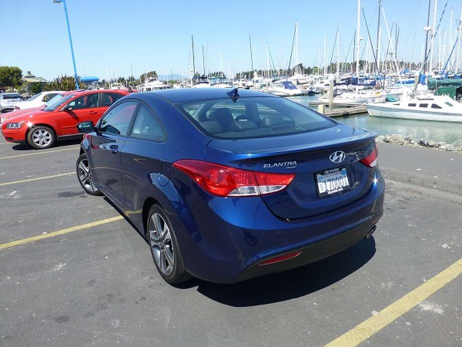 On the road, the Elantra Coupe was pretty quiet and its suspension soaked up most of the California roads' peculiarities. The transmission shifted smoothly and the engine, while somewhat anemic, at least gave pretty good mileage figures (27/37 mpg, city/highway).