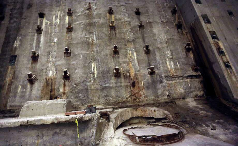 The slurry Wall, part of the World Trade Center's original foundation, is seen during a media tour of the National September 11 Memorial and Museum, Friday, Sept. 6, 2013 in New York. Construction is racing ahead inside the museum as the 12th anniversary of the Sept. 11, 2001 attacks draws near. Several more large artifacts have been installed in the cavernous space below the World Trade Center memorial plaza. (AP Photo/Mary Altaffer) ORG XMIT: NYMA112 Photo: Mary Altaffer, AP / AP