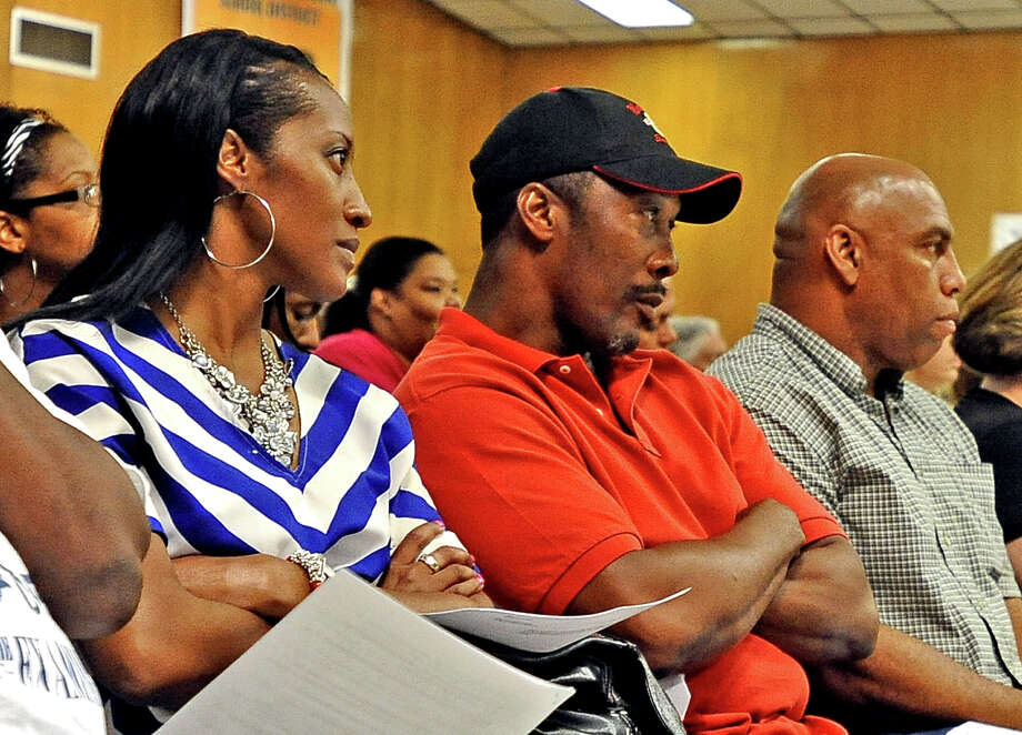 Calvin Walker, center, takes a his place on the front row during the BISD board meeting, in which the group discussed Walker's contract with the district on Tuesday, June 18, 2013. Photo taken: Randy Edwards/The Enterprise Photo: Randy Edwards