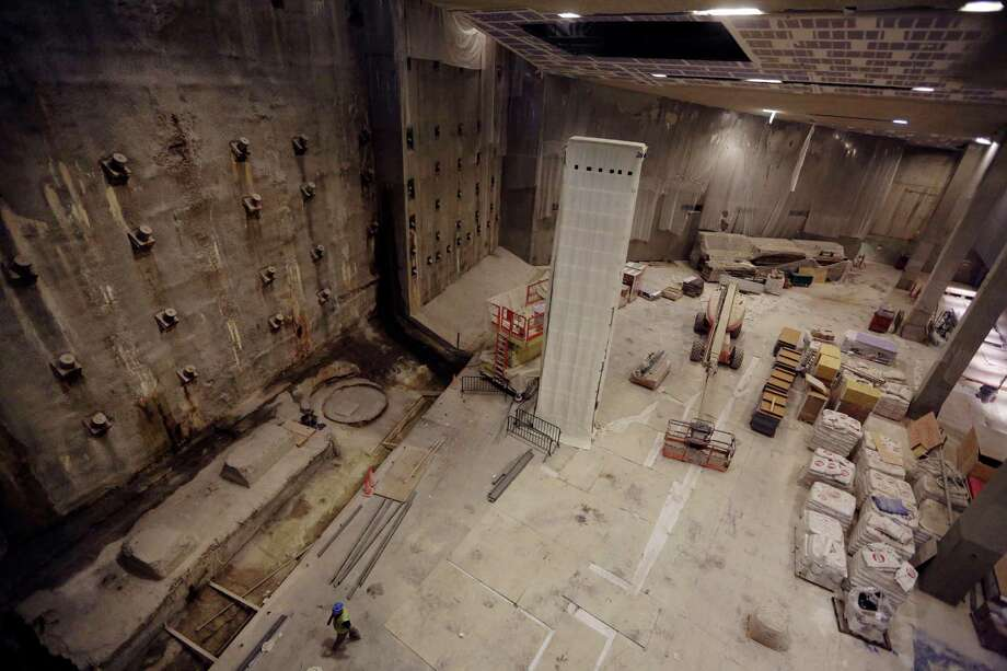 The slurry wall, left, part of the World Trade Center's original foundation and the last column removed from the WTC site, center covered in a protective wrap, are seen during a media tour of the National September 11 Memorial and Museum, Friday, Sept. 6, 2013 in New York. Construction is racing ahead inside the museum as the 12th anniversary of the Sept. 11, 2001 attacks draws near. Several more large artifacts have been installed in the cavernous space below the World Trade Center memorial plaza. (AP Photo/Mary Altaffer) ORG XMIT: NYMA104 Photo: Mary Altaffer, AP / AP