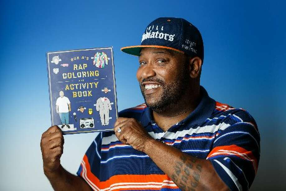 Bun B holding the new coloring and activities book, which will be released Sept. 17. (Chronicle Photo/Michael Paulsen)