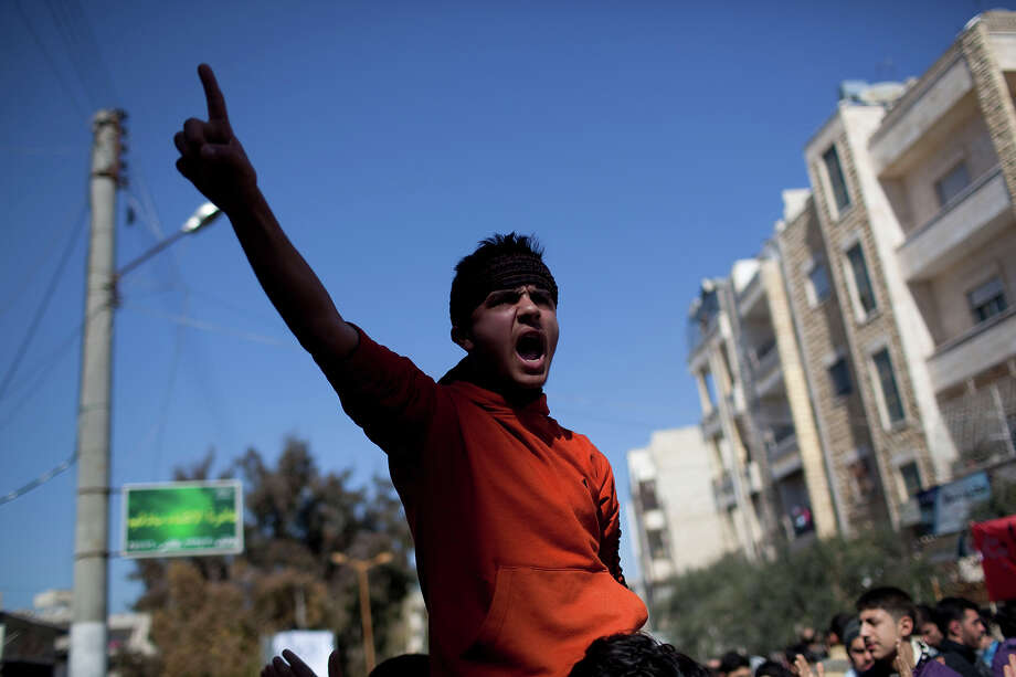 A man chants anti-government slogans during a demonstration in Idlib, north Syria, Friday, March 9, 2012. Photo: Rodrigo Abd, ASSOCIATED PRESS / AP2012