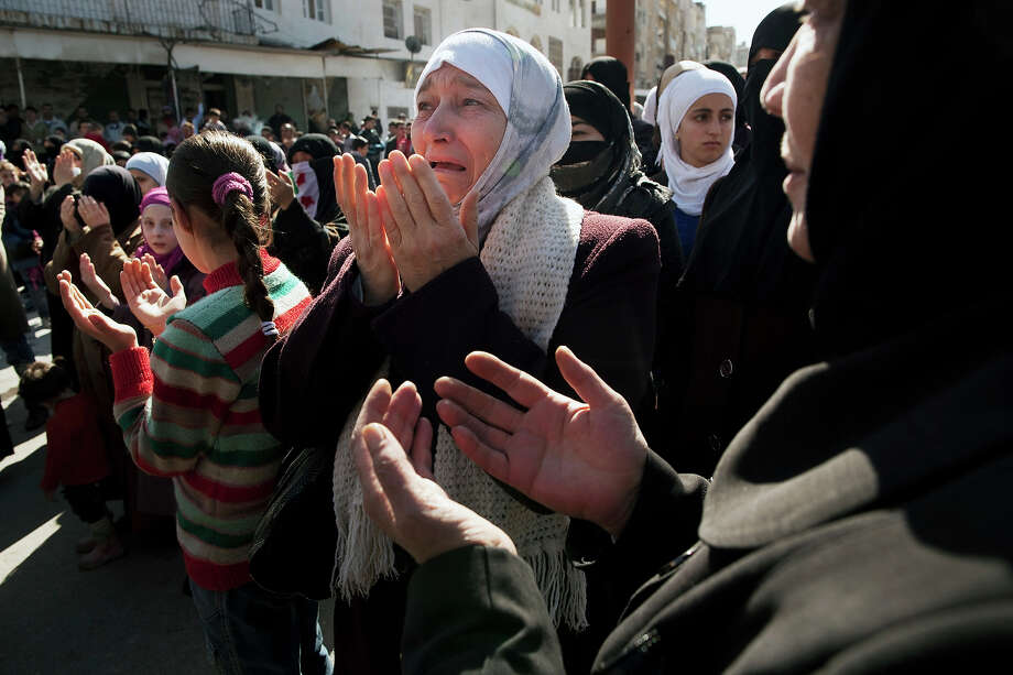 A woman weeps as she prays during an anti-government demonstration in Idlib, north Syria, Friday, March 9, 2012. Photo: Rodrigo Abd, ASSOCIATED PRESS / AP2012