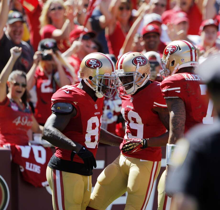 Anquan Boldin, Marlon Moore, center, and Colin Kaepernick, right, celebrate the 49ers' second touchdown in the first half. The San Francisco 49ers played the Green Bay Packers at Candelstick Park in San Francisco, Calif, on Sunday, September 8, 2013. Photo: Carlos Avila Gonzalez, The Chronicle