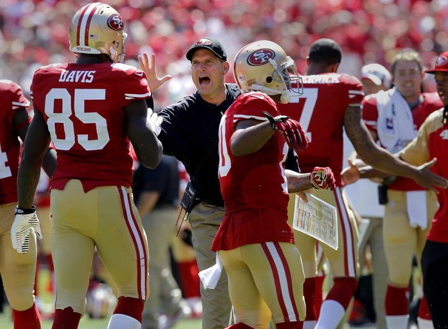 49ers coach Jim Harbaugh congratulated Vernon Davis (85) after his first half touchdown Sunday September 8, 2013. The San Francisco 49ers open their 2013 season with a 34-28 victory against the Green Bay Packers at Candlestick Park in San Francisco, Calif. Photo: Brant Ward, The Chronicle