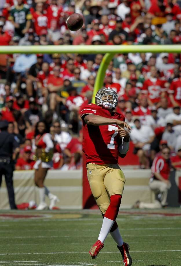 Colin Kaepernick completed a pass in the second quarter Sunday September 8, 2013. The San Francisco 49ers open their 2013 season with a 34-28 victory against the Green Bay Packers at Candlestick Park in San Francisco, Calif. Photo: Brant Ward, The Chronicle