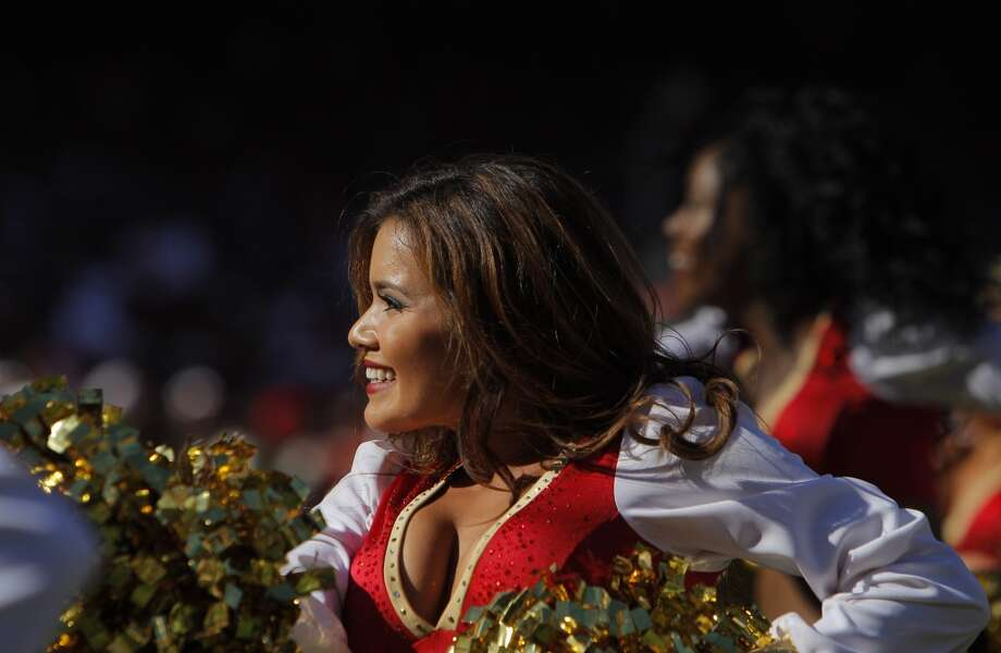 A San Francisco 49ers Gold Rush cheerleader cheers on Sept. 8, 2013. Photo: Carlos Avila Gonzalez, The Chronicle
