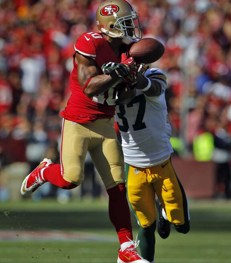 Green Bay's Sam Shields breaks up a pass intended for Kyle Williams that would have given the 49ers a first down in the fourth quarter. The San Francisco 49ers played the Green Bay Packers at Candelstick Park in San Francisco, Calif, on Sunday, September 8, 2013. Photo: Carlos Avila Gonzalez, The Chronicle