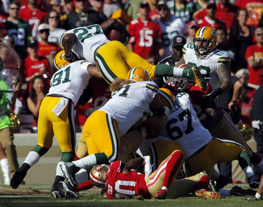 Eddie Lacy leaps over the scrum for a touchdown in the fourth quarter. The San Francisco 49ers played the Green Bay Packers at Candelstick Park in San Francisco, Calif, on Sunday, September 8, 2013. Photo: Carlos Avila Gonzalez, The Chronicle