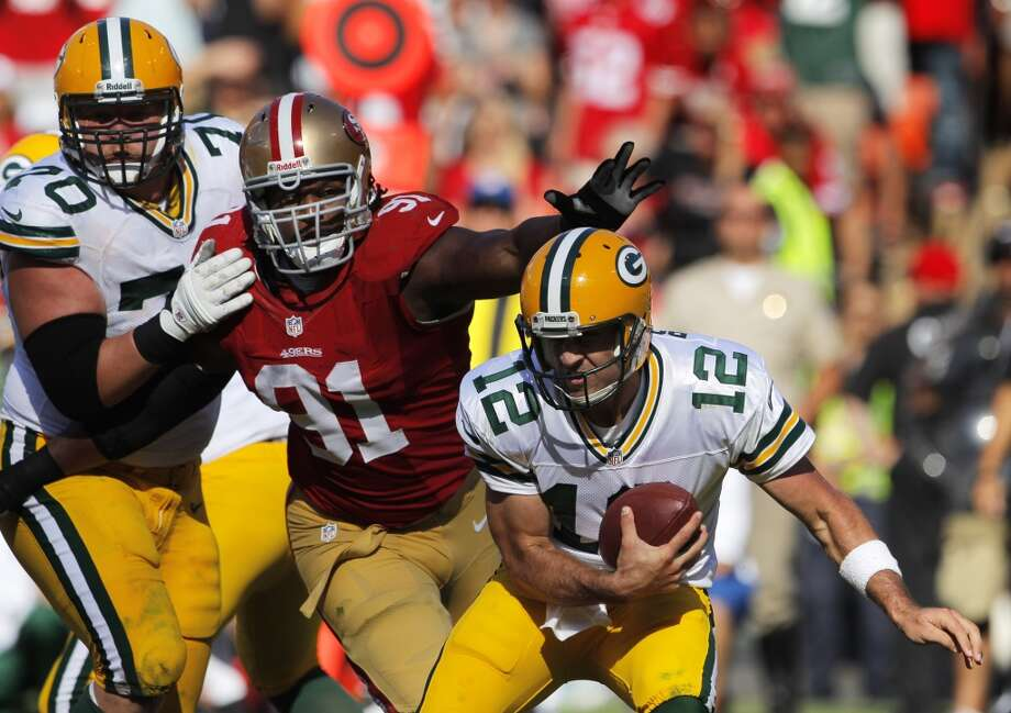 Ray McDonald pressures Aaron Rogers in the fourth quarter. The San Francisco 49ers played the Green Bay Packers at Candelstick Park in San Francisco, Calif, on Sunday, September 8, 2013. Photo: Carlos Avila Gonzalez, The Chronicle