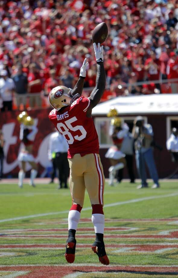 Vernon Davis shoots the ball over the uprights after he scored the 49ers first touchdown in the first quarter. The San Francisco 49ers played the Green Bay Packers at Candelstick Park in San Francisco, Calif, on Sunday, September 8, 2013. Photo: Carlos Avila Gonzalez, The Chronicle