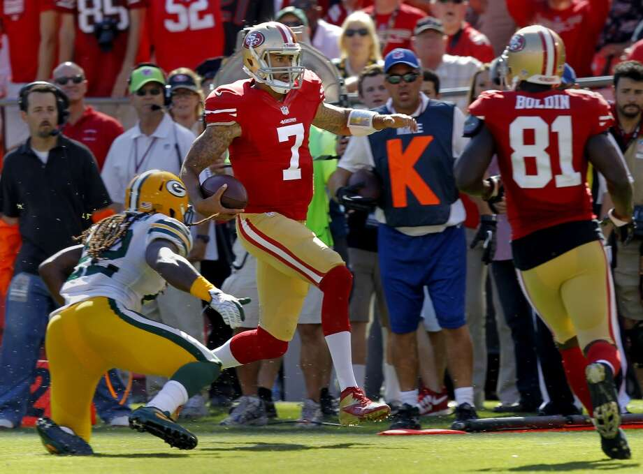 Colin Kaepernick took off on a running play for a big gain the second half Sunday September 8, 2013. The San Francisco 49ers open their 2013 season with a 34-28 victory against the Green Bay Packers at Candlestick Park in San Francisco, Calif. Photo: Brant Ward, The Chronicle