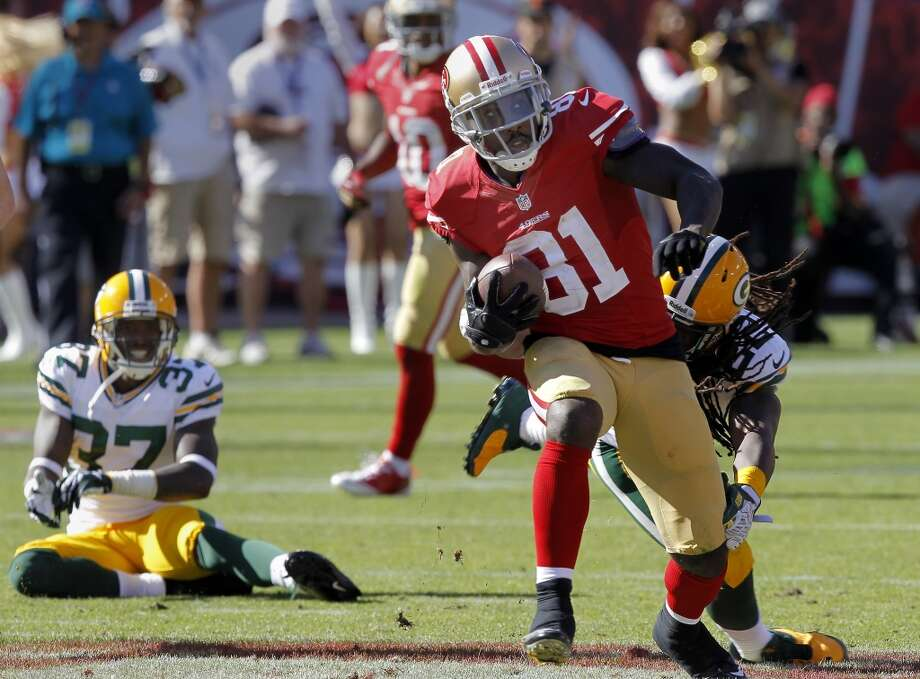 Anquan Boldin (81) broke a tackle and headed upfield after a catch in the second half Sunday September 8, 2013. The San Francisco 49ers open their 2013 season with a 34-28 victory against the Green Bay Packers at Candlestick Park in San Francisco, Calif. Photo: Brant Ward, The Chronicle