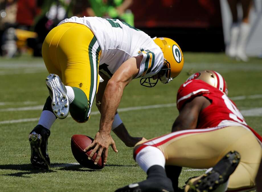 Aaron Rodgers loses the ball in a play during the first series Sunday September 8, 2013. The San Francisco 49ers open their 2013 season with a 34-28 victory against the Green Bay Packers at Candlestick Park in San Francisco, Calif. Photo: Brant Ward, The Chronicle