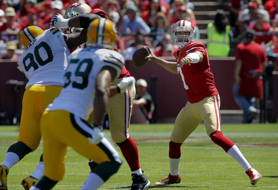 Colin Kaepernick threw for a completion in the first half Sunday September 8, 2013. The San Francisco 49ers open their 2013 season with a 34-28 victory against the Green Bay Packers at Candlestick Park in San Francisco, Calif. Photo: Brant Ward, The Chronicle
