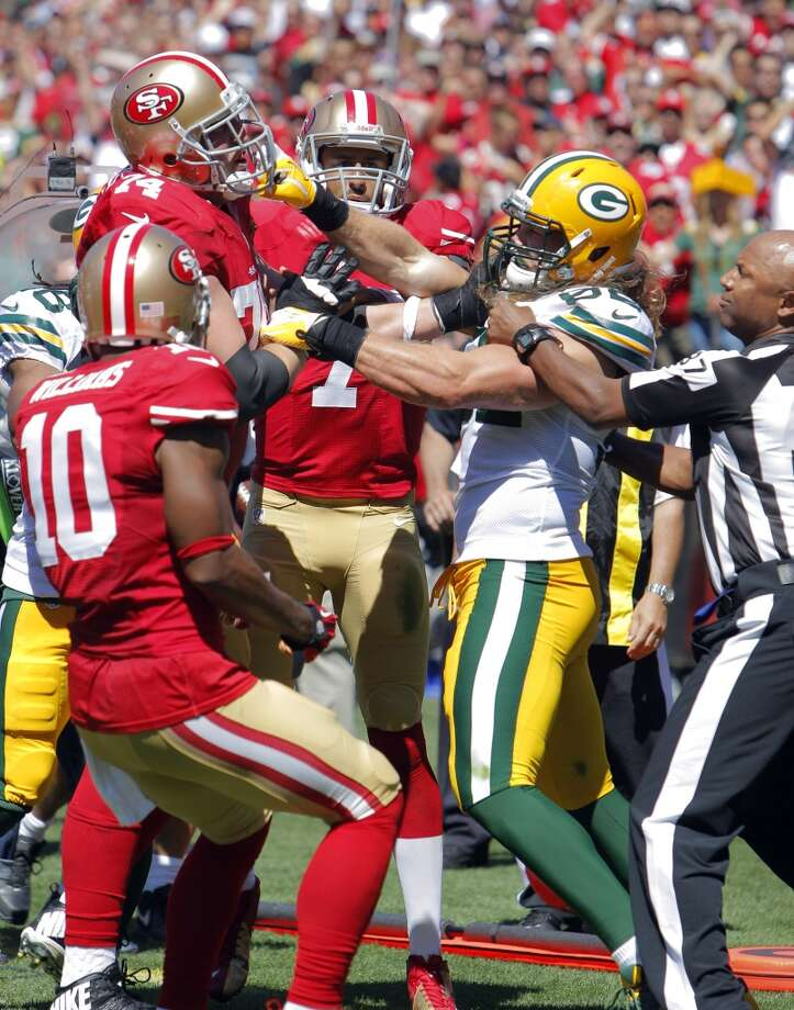 Joe Staley, left, and Green Bay's Clay Matthews get into a fight after Matthews hit Colin Kaepernick when he was already out of bounds in the second quarter.  The San Francisco 49ers played the Green Bay Packers at Candelstick Park in San Francisco, Calif, on Sunday, September 8, 2013. Photo: Carlos Avila Gonzalez, The Chronicle