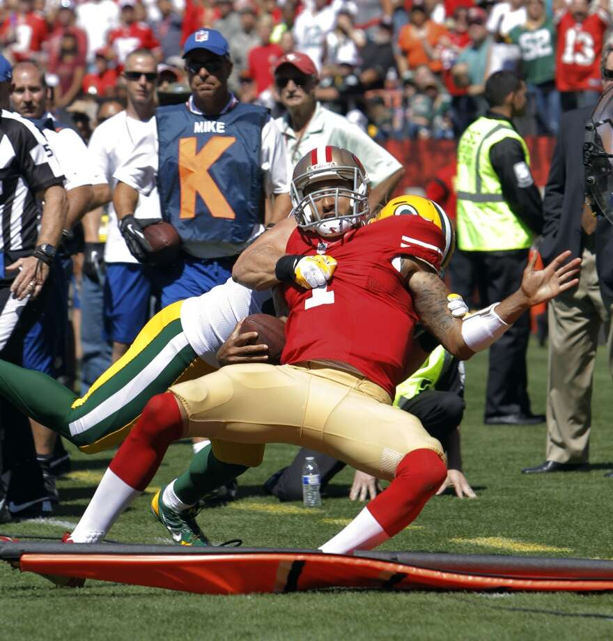 Colin Kaepernick is hit out of bounds by Green Bay's Clay Matthews in the second quarter. The hit sparked a fight between several players.  The San Francisco 49ers played the Green Bay Packers at Candelstick Park in San Francisco, Calif, on Sunday, September 8, 2013. Photo: Carlos Avila Gonzalez, The Chronicle
