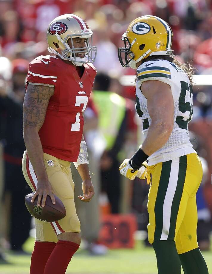 San Francisco 49ers quarterback Colin Kaepernick (7) talks with Green Bay Packers outside linebacker Clay Matthews (52) during the second half of an NFL football game in San Francisco, Sunday, Sept. 8, 2013. (AP Photo/Ben Margot) Photo: Ben Margot, Associated Press