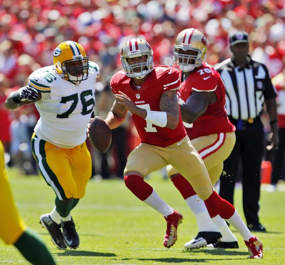 Colin Kaepernick scrambles in the first quarter. The San Francisco 49ers played the Green Bay Packers at Candelstick Park in San Francisco, Calif, on Sunday, September 8, 2013. Photo: Carlos Avila Gonzalez, The Chronicle