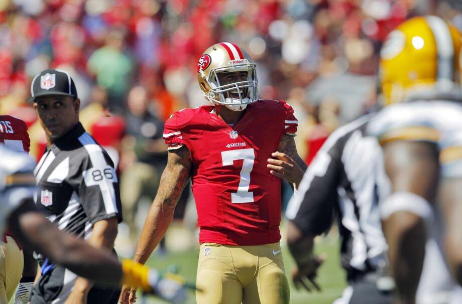 Colin Kaepernick laughs after he was hit by Clay Matthews while out of bounds in the first half. The San Francisco 49ers played the Green Bay Packers at Candelstick Park in San Francisco, Calif, on Sunday, September 8, 2013. Photo: Carlos Avila Gonzalez, The Chronicle