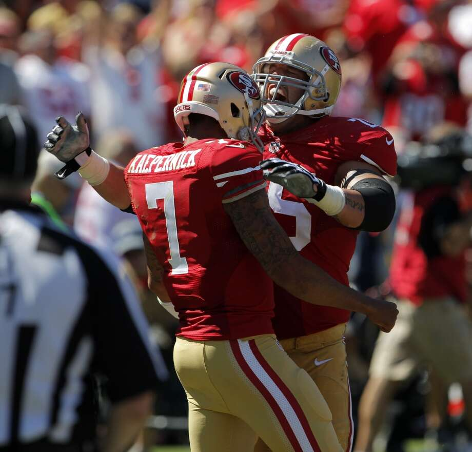 Alex Boone celebrates the 49ers' second touchdown with Colin Kaepernick in the first quarter. The San Francisco 49ers played the Green Bay Packers at Candelstick Park in San Francisco, Calif, on Sunday, September 8, 2013. Photo: Carlos Avila Gonzalez, The Chronicle
