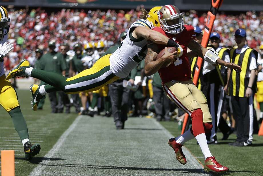 San Francisco 49ers quarterback Colin Kaepernick (7) runs out of bounds as Green Bay Packers outside linebacker Clay Matthews dives for him during the second quarter of an NFL football game in San Francisco, Sunday, Sept. 8, 2013. (AP Photo/Ben Margot) Photo: Ben Margot, Associated Press