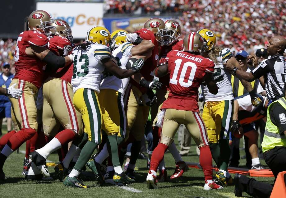 San Francisco 49ers offensive tackle Joe Staley, center facing right, is held back as he approaches Green Bay Packers outside linebacker Clay Matthews, right, after Matthews tackled quarterback Colin Kaepernick during the second quarter of an NFL football game in San Francisco, Sunday, Sept. 8, 2013. Photo: Ben Margot, Associated Press