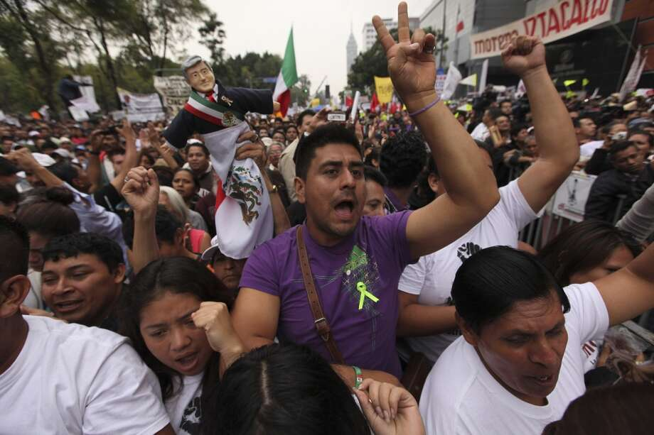 Supporters of former presidential candidate Andres Manuel Lopez Obrador cheer as they listen to Lopez Obrador during an act to protest against the government's proposed energy reforms that would allow private companies to explore the country's oil and gas reserves, in Mexico City, Sunday Sept. 8, 2013. The proposed reform requires constitutional changes that strike at the heart of one of Mexico's proudest moments: President Lazaro Cardenas' nationalization of the oil company in 1938. (AP Photo/Marco Ugarte) Photo: Marco Ugarte, Associated Press