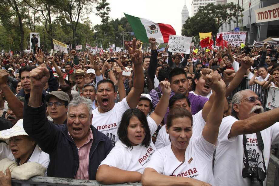 Supporters of former presidential candidate Andres Manuel Lopez Obrador cheer as they listen to Lopez Obrador during an act to protest against the governments proposed energy reforms that would allow private companies to explore the country's oil and gas reserves, in Mexico City, Sunday Sept. 8, 2013. The proposed reform requires constitutional changes that strike at the heart of one of Mexico's proudest moments: President Lazaro Cardenas' nationalization of the oil company in 1938. (AP Photo/Marco Ugarte) Photo: Marco Ugarte, Associated Press