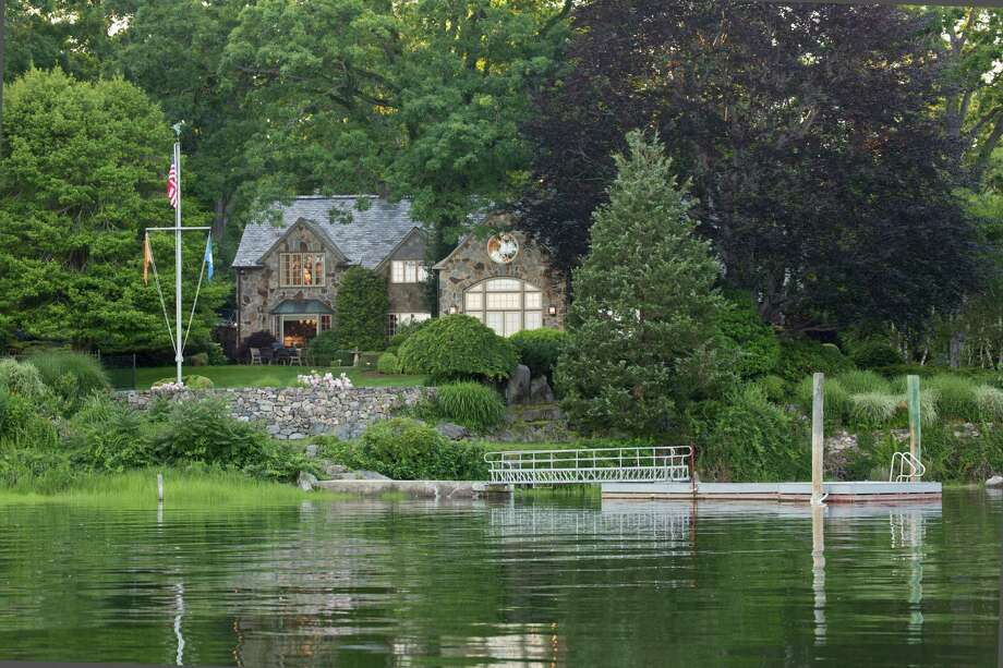 The stone Colonial at 82 Arrowhead Way was designed by architect Frazier Peters and is situated on a hill overlooking Scotts Cove and the Darien Land Trust. It is on the market for $7,900,000. Photo: Contributed Photo, Contributed / Darien News