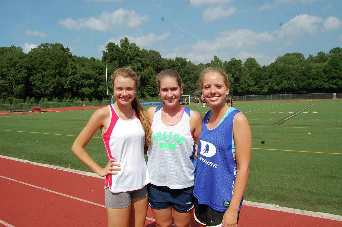 From left, three Darien captains Grace Evanich, Barbara Bell and Alex Ford pose for a picture before a preseason practice. Missing: Kerry Donovan. By Dave Crandall