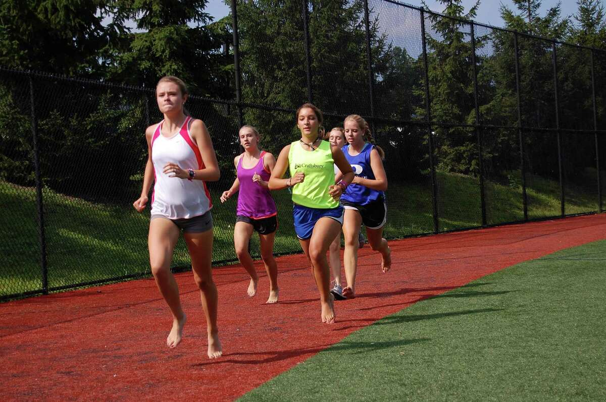 The Darien girls cross country team trains for the upcoming season. By Dave Crandall