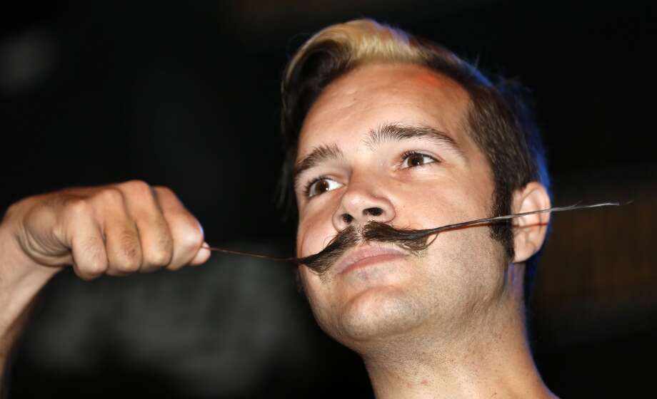 Brian Werle shows off his mustache while competing in the English Moustache division during the fourth annual Just For Men National Beard and Moustache Championships. Photo: Susan Poag, Associated Press