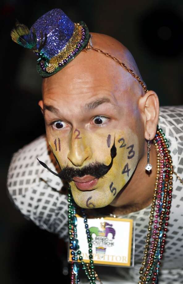 Keith Haubrich of Seattle, Wash., reacts to the crowd while competing in the Dali Moustache division. Photo: Susan Poag, Associated Press