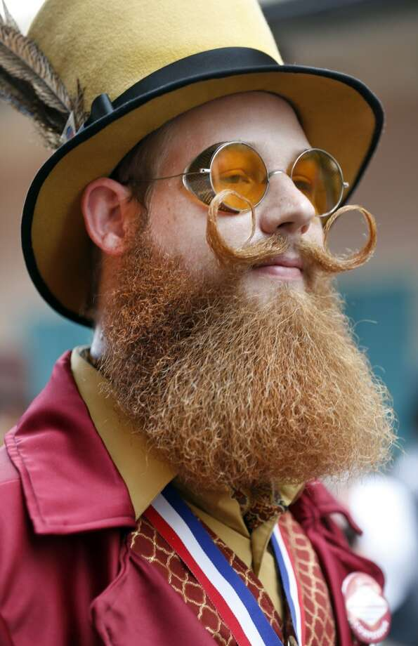 Jeffrey Moustache parades with contestants through the French Quarter. Photo: Susan Poag, Associated Press