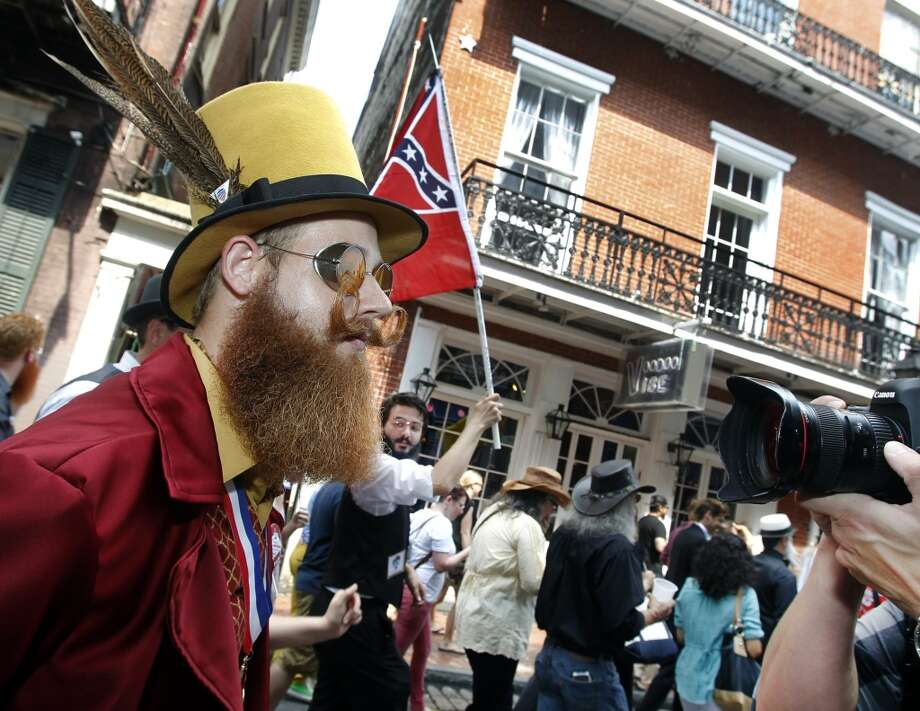 Jeffrey Moustache keeps eyes straight ahead as a photographer singles him out. Photo: Susan Poag, Associated Press